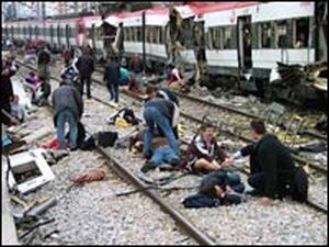Victims sit on the tracks just outside Madrid's Atocha station.