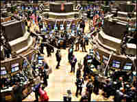 Traders work on the main trading floor of the New York Stock Exchange.