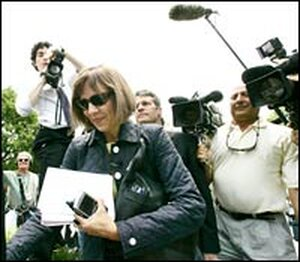 'New York Times' reporter Judith Miller walks towards the federal district courthouse.