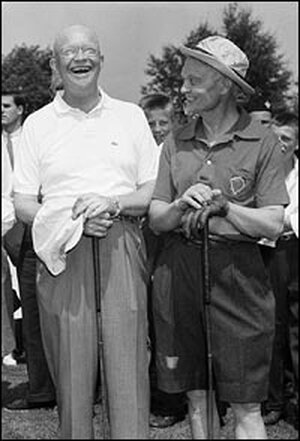 President Eisenhower enjoys a laugh with Sherman Adams.