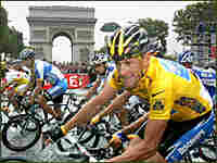 Discovery Channel team rider Lance Armstrong of the U.S. passes the Arc de Triomphe in Paris.