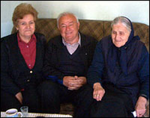 Milorad Pavlovic, with his wife and mother.