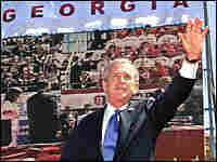 President George W. Bush waves to a large crowd of Georgians as he arrives to speak in Tbilisi