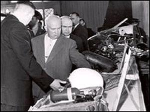 Soviet Premier Nikita Khrushchev examines items retrieved from the downed U-2 spy plane.