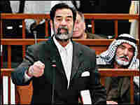 Former Iraqi leader Saddam Hussein appears in a Baghdad courtroom Monday, Nov. 28.