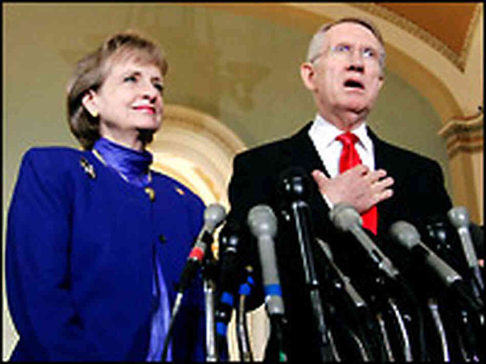 Supreme Court nominee Harriet Miers listens to Senate Minority Leader Harry Reid.