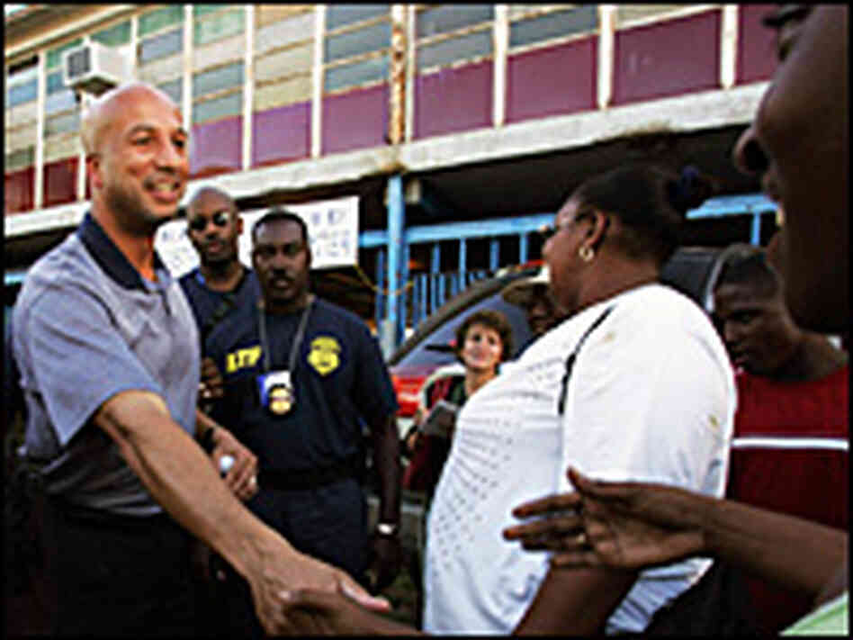 New Orleans Mayor Ray Nagin greets residents outside a disaster relief center in the