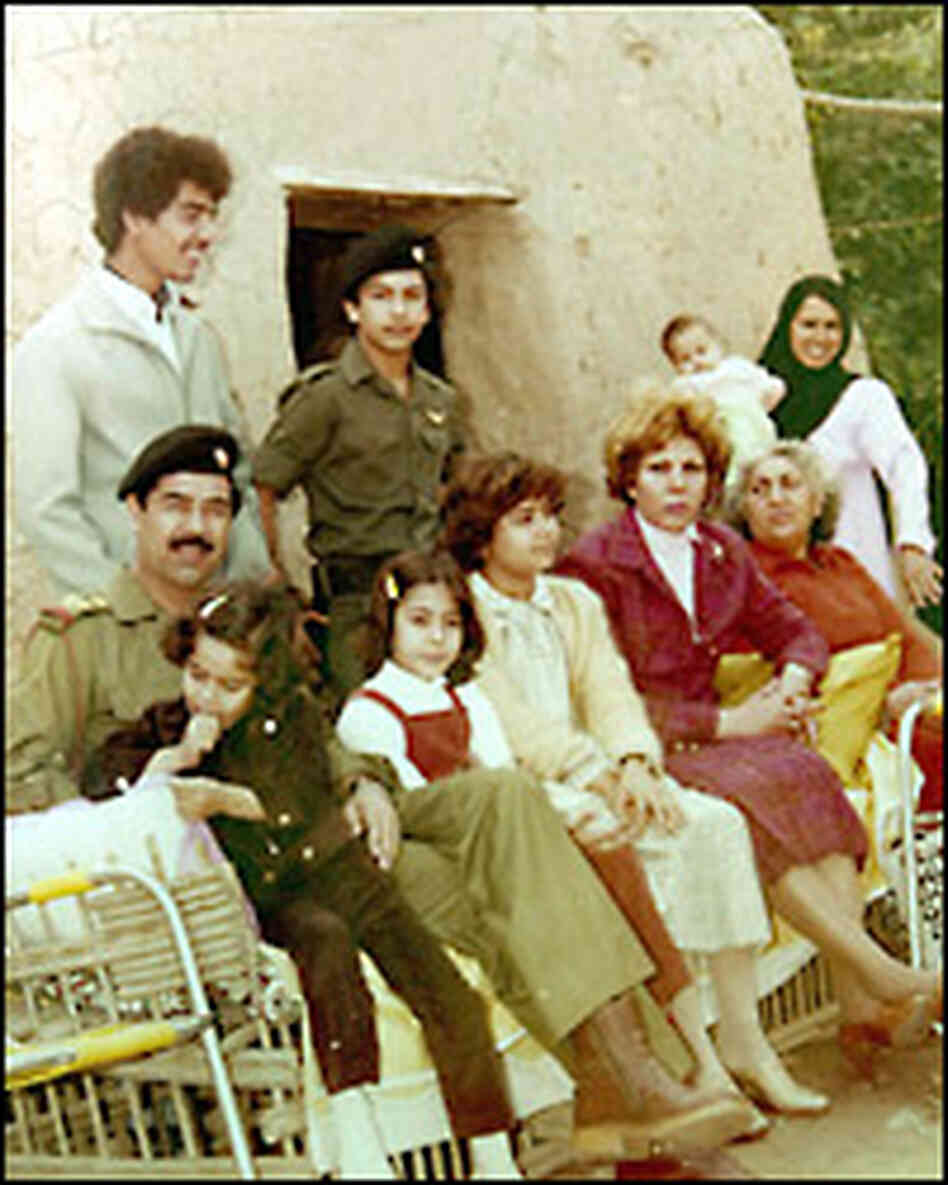 Saddam and his family outside of the clay hut in which he was born. Credit: Corbis.