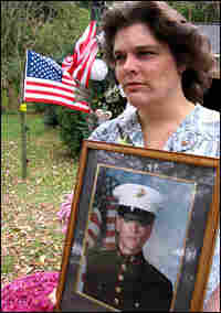 Janey Harrah holds a photo of her son, Lance Cpl. Daniel Bubb.