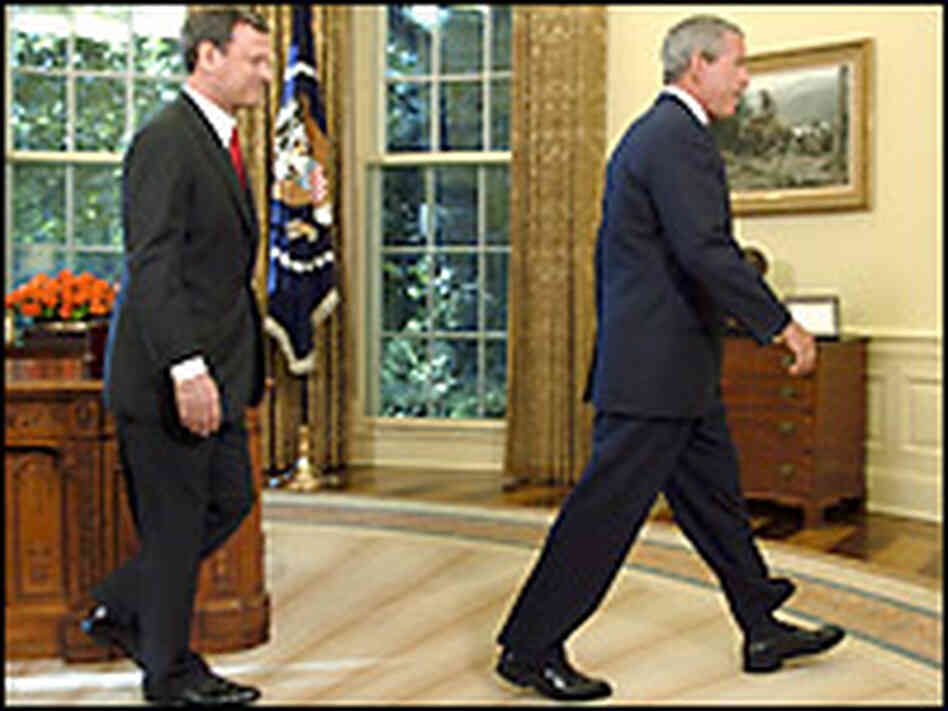 Roberts with President Bush. Credit: Reuters