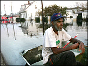 Errol Morning, 60, sits on his boat on a flooded street in New Orleans Sept. 5.