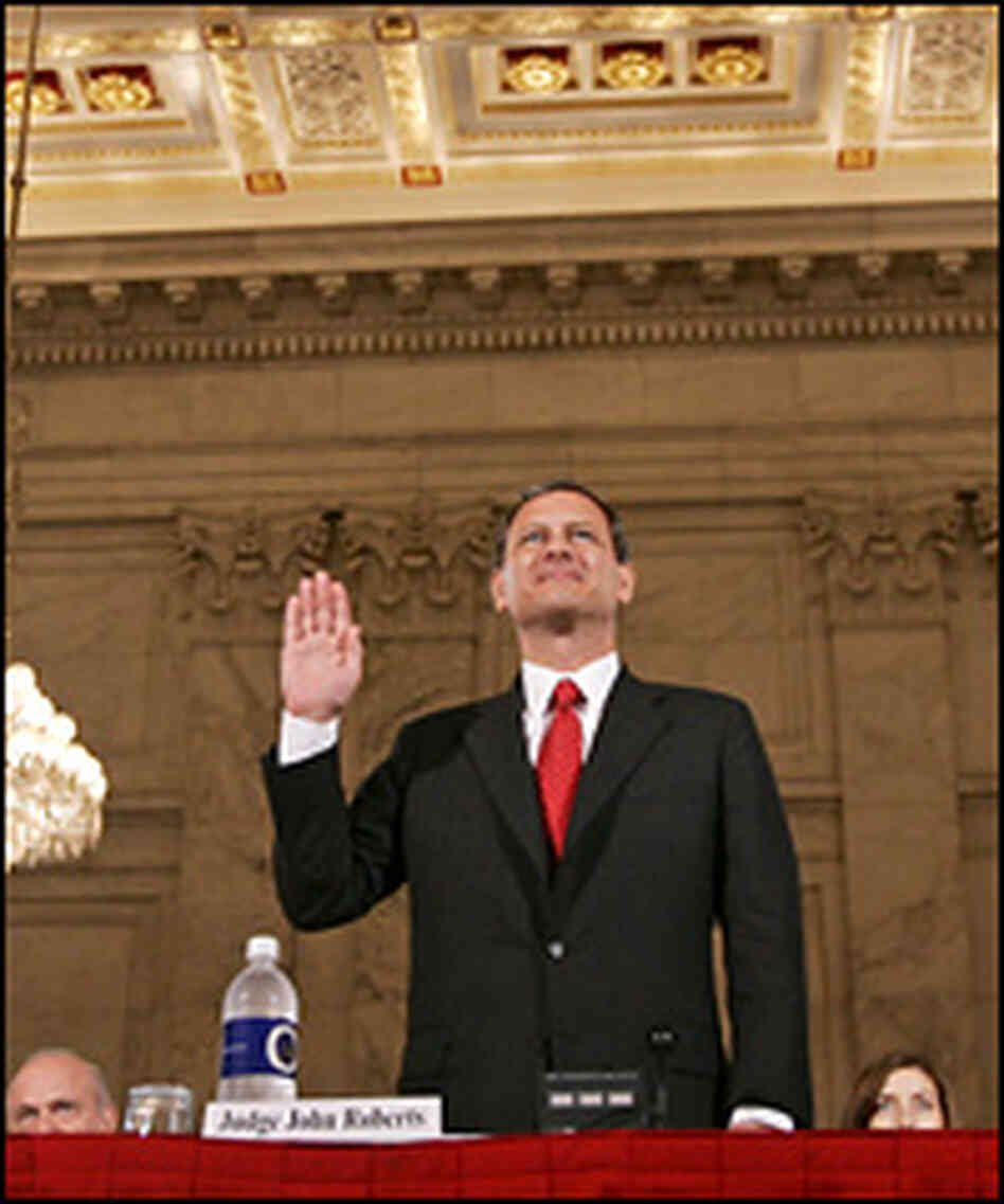 John Roberts, chief justice nominee, raises his right hand as he is sworn in to testify.