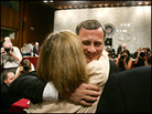 Chief Justice nominee John Roberts hugs his wife Jane on Capitol Hill.