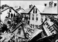 People stand amid the destruction in Johnstown. Credit: Johnstown Area Heritage Association.
