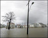 Homes in Orleans Parish are flooded after surging waters from Hurricane Rita overtopped a western section of the levee along the Industrial Canal, Sept. 23, 2005.