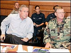President George W. Bush (C) receives a briefing from U.S. military Joint Task Force-RITA officials.