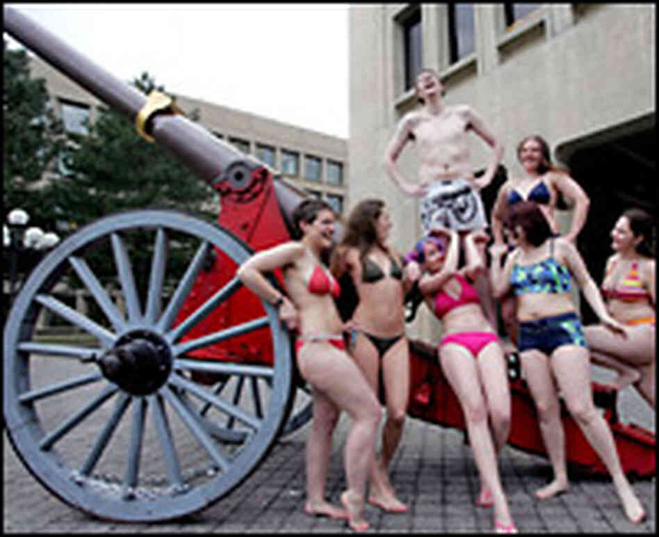 Bikini-clad MIT students gather around a cannon stolen from Caltech's campus.