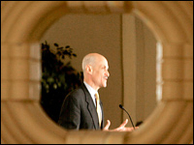 Homeland Security head Michael Chertoff is seen through a mirror during a recent trip to Capitol Hill.