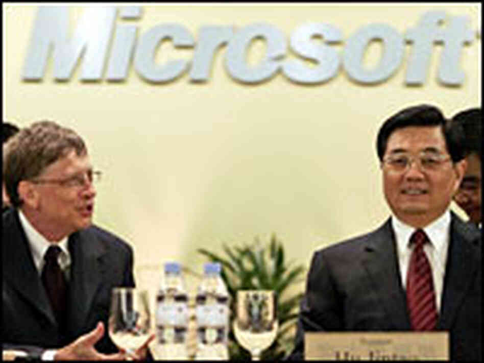 Chinese President Hu Jintao listens to Microsoft Chairman Bill Gates during a visit to Redmond, Wash