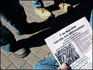A day laborer in Annandale, Va., reads a boycott flier
