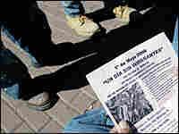 A day laborer in Annandale, Va., reads a boycott flier