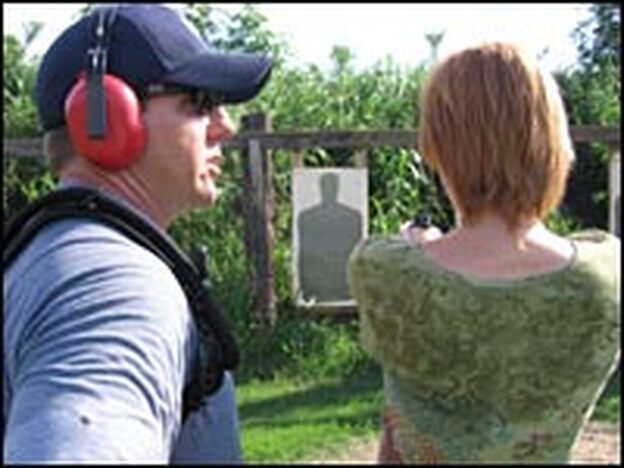 Gun-safety instructor John Oleaga advises Cheryl Moser, of the Gentilly neighborhood of New Orleans, during her first shots at the gun range.
