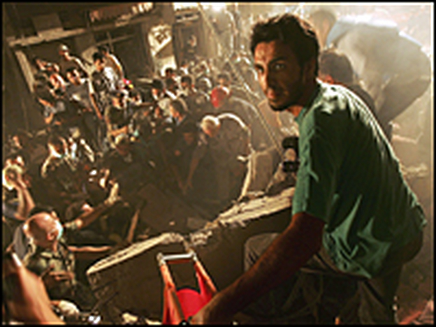 People try to rescue survivors at the scene of a building that collapsed after an Israeli attack, August 7, 2006 in Beirut, Lebanon. The evening target was the closest yet Israeli has come to targeting the center of Beirut.