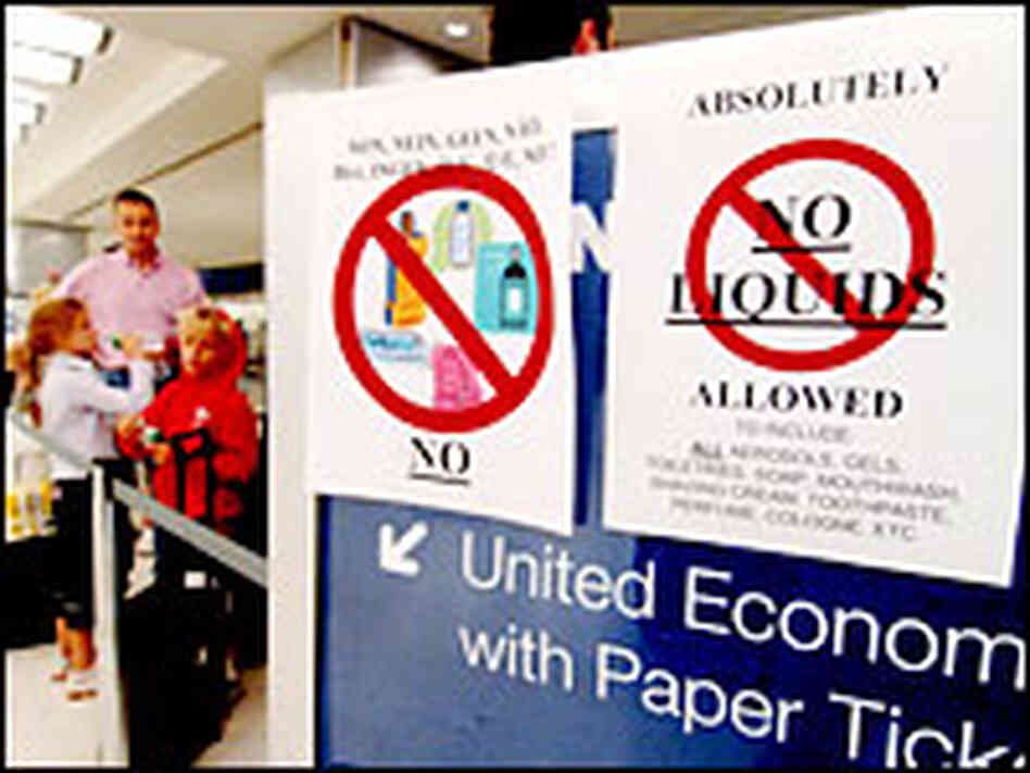 New restrictions prohibiting any liquids in carry-on luggage are posted Thursday
