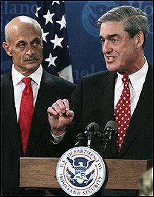 Homeland Security Secretary Michael Chertoff watches as FBI Director Mueller answers a question.