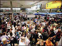 Passengers at London's Heathrow airport on Thursday. Credit: AP Photo/Kirsty Wigglesworth.