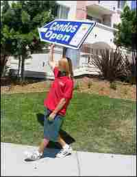Scott Webb holds up a condo sign.