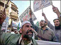 Pakistani Islamist activists carry placards and chant slogans during a protest rally in Peshawar.