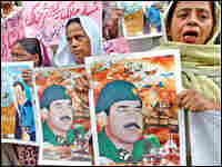 With Saddam Hussein's execution looming, Pakistani protesters shout slogans at a rally in Karachi.
