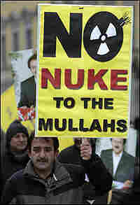 Protester holds placard that says 'No Nukes for Iran Mullahs'