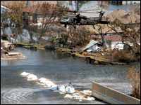 A Texas Army National Guard Helicopter Deposits 6000 Pound Plus Bag Of Sand And Gravel To Try Close The Breach In 17th Street Canal Sept