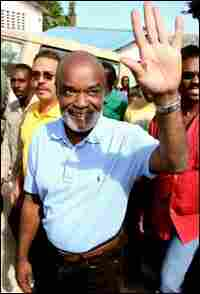 Haitian presidential candidate Rene Preval waves to supporters.