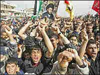 Angry Iraqi Shiites demonstrate in Baghdad's poor neighborhood of Sadr City.