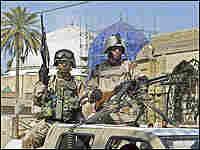 Iraqi soldiers guard a Sunni mosque in Baghdad.