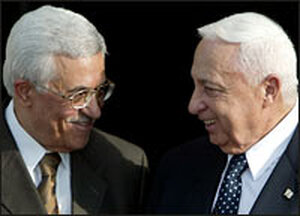 Palestinian Prime Minister Mahmoud Abbas (left) and Israeli Prime Minister Ariel Sharon meet.