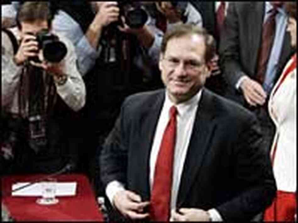 U.S. Supreme Court nominee Samuel Alito walks away from his table