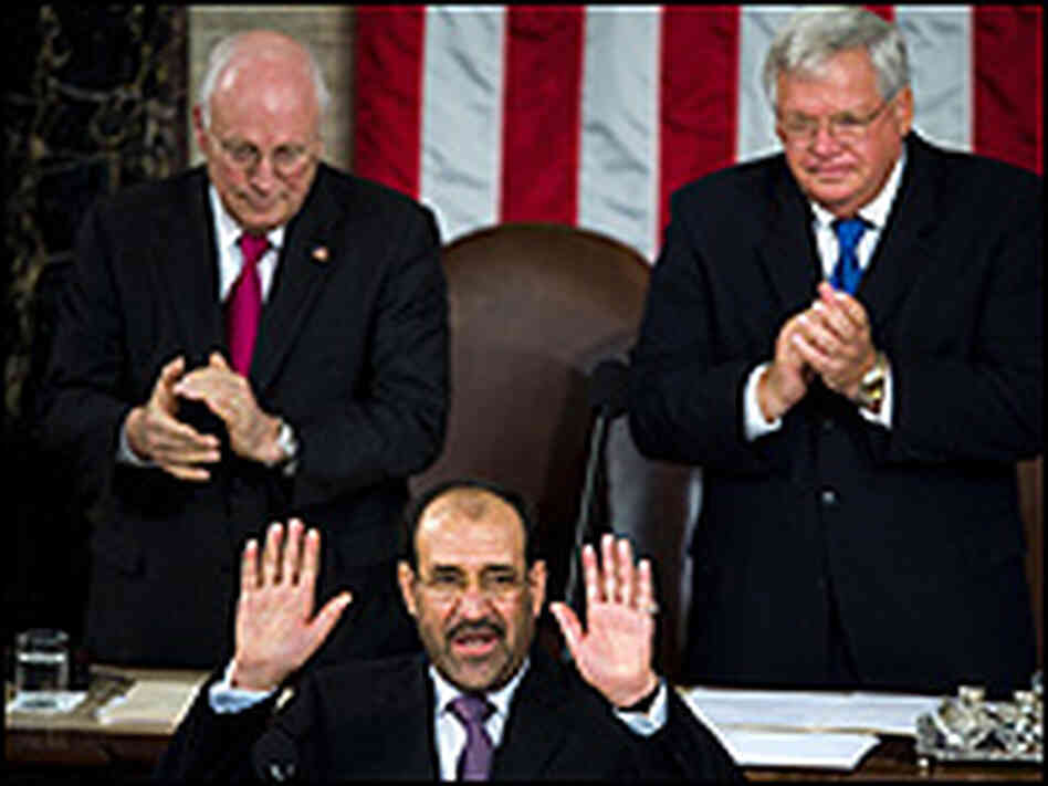 Iraqi Prime Minister Nouri al-Maliki acknowledges applause from the assembled U.S. Congress.