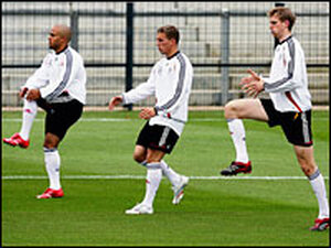 Members of the German World Cup soccer team warm up during during a training session in Berlin