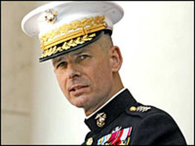 Gen. Peter Pace, Chairman, Joint Chiefs of Staff, attends the annual Memorial Day commemoration at Arlington National Cemetery, May 29, 2006. Pace keeps on his desk a photograph of the first Marine he lost in combat.