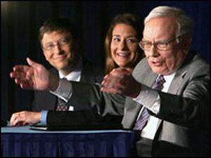 Warren Buffett, right, speaks alongside Bill and Melinda Gates as they detail Buffett's gift.