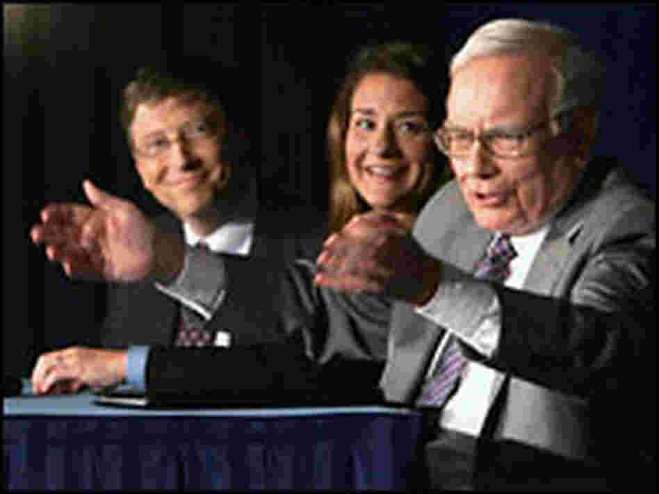 Warren Buffett, right, speaks alongside Bill and Melinda Gates as they detail Buffett's gift.