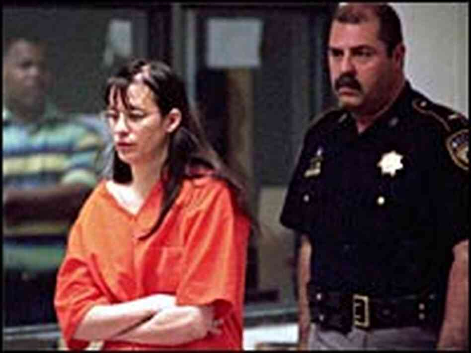 Andrea Yates is escorted into court by a sheriff in this file photo from June 2001.