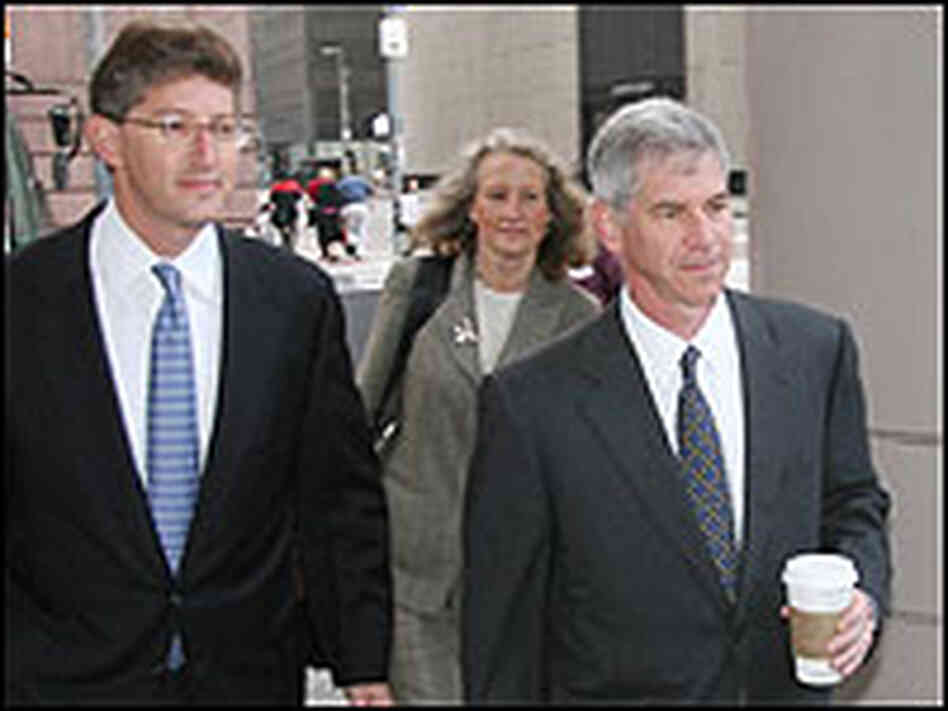 Andrew Fastow, with coffee cup, arrives at federal court in Houston with attorney David Gerger.