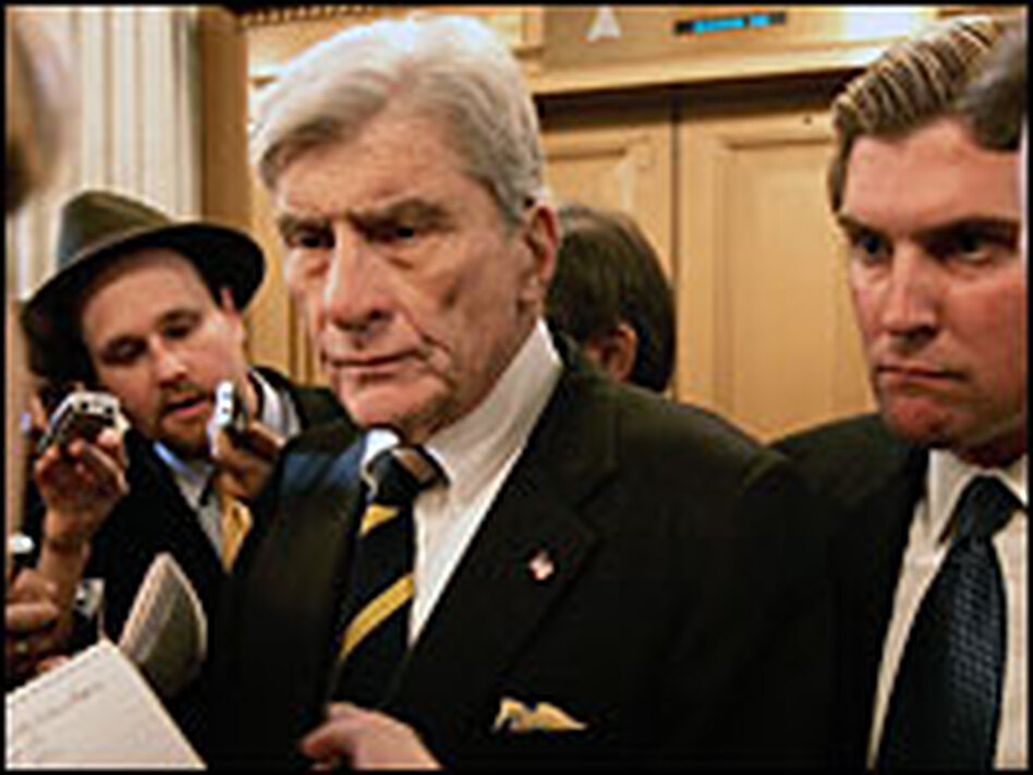 U.S. Sen. John Warner (R-VA) speaks with reporters about the Dubai ports deal on Capitol Hill March 9, 2006.
