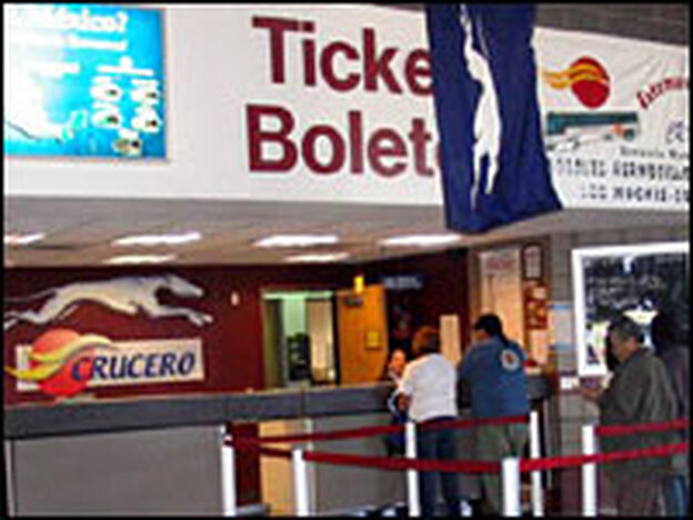 Travelers line up at the ticket both at the Greyhound station in Phoenix. U.S. Border Patrol agents police the station because they say the city has become a major hub for illegal immigration.