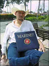 Josh Elmore keeps a scrapbook of his first tour of Iraq.